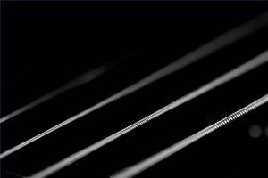 Comment cordes d'une guitare Fender Mustang