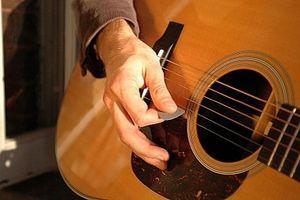 Comment tenir un pick Guitare