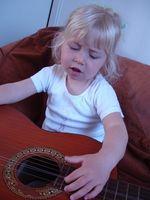 Comment apprendre à votre enfant de la guitare