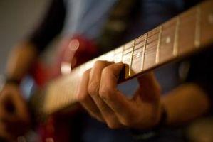 Comment tenir vos doigts sur les frettes d'une guitare